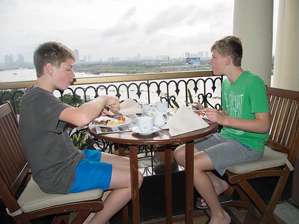 Eating baked beans to afford buttery croissants for breakfast on the rooftop of The Hotel Majestic in Ho Chi Minh City was worth it!